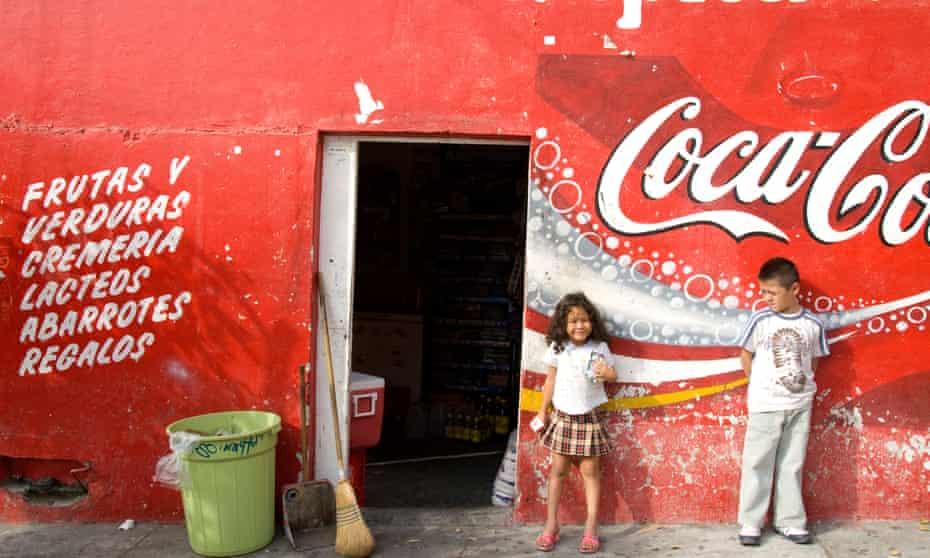 Two children outside a local market in Mazatlan,  Mexico