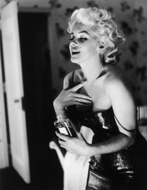 Marilyn Monroe with Chanel No 5 (1955) photographed by Ed Feingersh