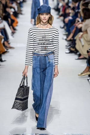 A model wears a slogan tee on the Dior catwalk.