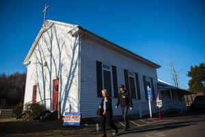 Two voters leave the Graves chapel, used as a county voting location, in Graves Mill, Virginia.