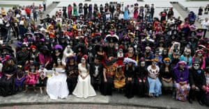 Mexico: People dress up like the character La Calavera Catrina, an elegant skeleton created by artist José Guadalupe Posada in the 1900s, to take part in the annual Catrina Festival on the Day of the Dead