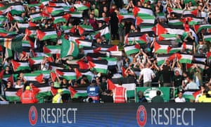 Celtic fans hold up Palestine flags.