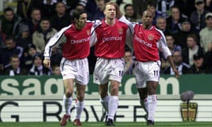 Arsenal's Dennis Bergkamp celebrates with his team-mates Robert Pires and Sylvain Wiltord after scoring against Arsenal