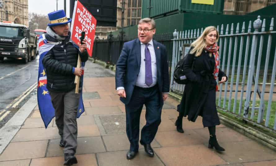 An anti-Brexit protester challenges Mark Francois outside parliament in London.