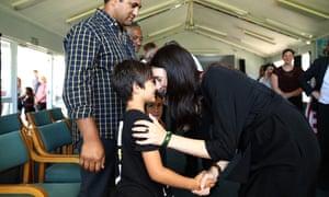 Jacinda Ardern hongis with Nikau Taituha from Paihia primary school on 5 February in Waitangi.