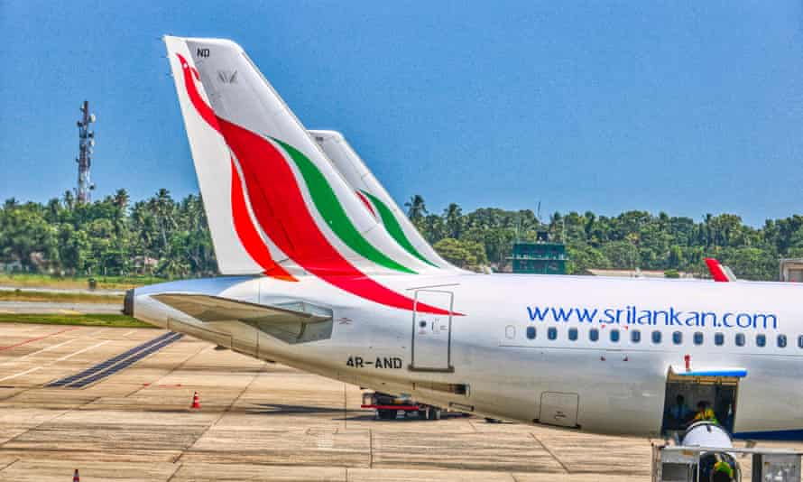 Photo shows two planes in a row standing at Bandaranaike International Airport Colombo, Sri Lanka.