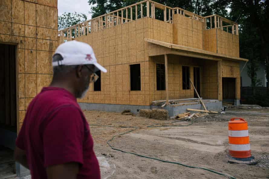 Suffolk, VA -- Pughsville-Suffolk Civic League president Wayne White looks at a new building in his historic African American community.