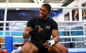Anthony Joshua tapes his hands up prior to a training session in Sheffield earlier this month.