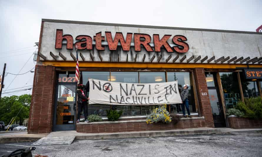 Protestors raise a sign in front of hatWRKS in Nashville, Tennessee on May 29.