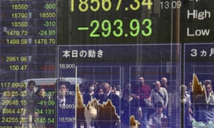 An electronic stock indicator of a securities firm in Tokyo as Asian markets fall