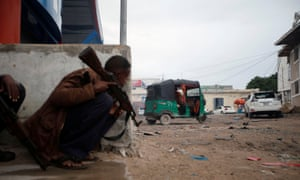 A Somali soldier during gunfire after a suicide bomb attack outside Naasa Hablood hotel in Somalia's capital Mogadishu on 25 June 2016.