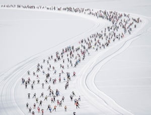 Athletes compete on the way from Maloya to S-Chanf during the 51st annual Engadin skiing marathon in Sils, Switzerland on 10 March.