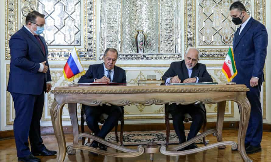 The Iranian foreign minister, Javad Zarif, second from right, and his Russian counterpart, Sergei Lavrov, sign documents at a meeting in Tehran