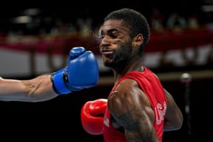 USA's Delante Marquis Johnson takes a punch from Argentina's Brian Agustin Arregui during their welterweight boxing match.