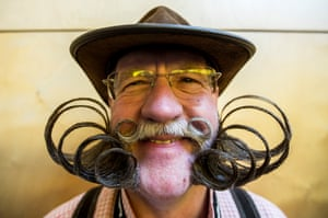 A contestant of the World Beard And Mustache Championships poses for a picture during the Championships
