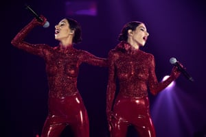 The Veronicas perform in latex pants and glitter body paint to open the 30th annual Aria awards at The Star, in Sydney on Wednesday.