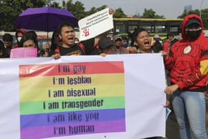 LGBT activists during a rally against the planned revisions to Indonesia's criminal code outside the Parliament in Jakarta, Indonesia, 12 February 2018.