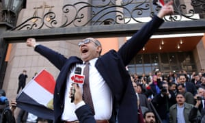 Egyptian lawyer Khaled Ali celebrates outside the courthouse in Cairo after the verdict