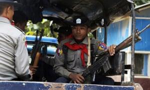 Myanmar police officers patrol Maungdaw, Rakhine State, Myanmar, in the wake of October's attacks.