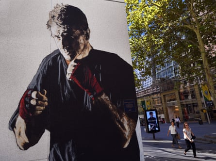 A portrait of Father Dave Smith by the artist E.L.K adorned the side of a building in Sydney's Martin Place.