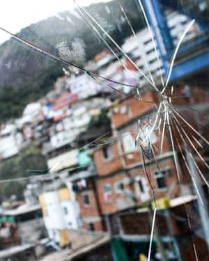 A hole caused by a ricochet: a salutary reminder of life in the favela