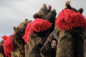 A child wears a bear costume during an annual ritual in Comanesti, Romania