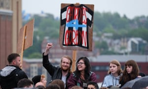 Young people hold a sign saying 'Geordies 4 Corbyn' at a rally in Gateshead.