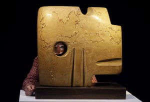 London, England A Christie's employee looks through a Henry Moore sculpture called Square Form, 1936, at Christie's auction rooms. The sculpture is expected to fetch about £3m-£5m at auction in the Modern British Art Evening sale on 21 January