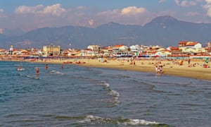 Waves roll onto the shore on a sunny day at one of Viareggio's many beaches. Italy.