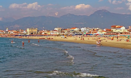 Waves roll onto the shore on a sunny day at one of Viareggio's many beaches. Italy.
