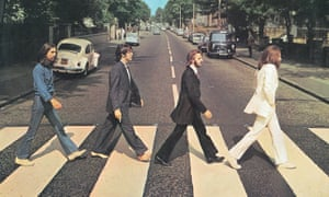 The Beatles on their Abbey Road album cover from 1969