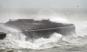 Waves crash over the harbour wall in Dover, Kent, on 14 January during Storm Brendan