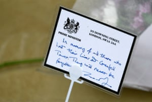 Theresa May's tribute to victims is displayed near Grenfell Tower