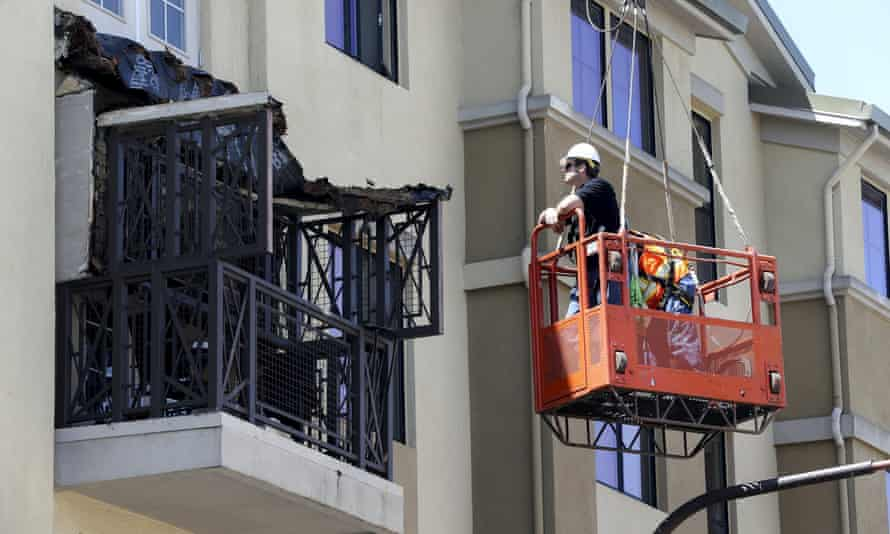 Workmen examine the damage at the scene of the balcony collapse in Berkeley.
