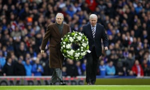 John Greig former Rangers captain and Billy McNeill former Celtic captain hold a wreath in January 2011