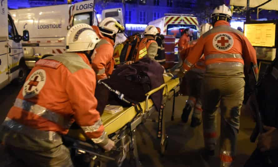 French Red Cross rescue workers evacuate an injured person