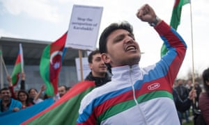 Azeri supporters gather outside the chancellery in Berlin during a meeting between Angela Merkel and Armenian president Serzh Sarkisian.