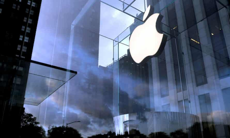 The Apple Inc logo is seen hanging at the entrance to the Apple store on 5th Avenue in Manhattan, New York