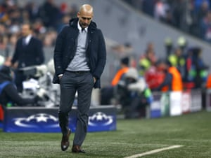 Bayern's head coach Pep Guardiola cuts a disconsolate figure.
