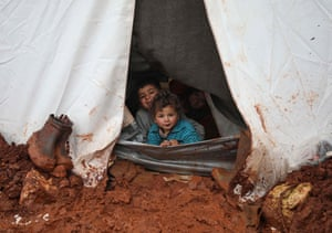 Children sit in their tent at the Cordoba camp for internally-displaced persons in the northern Syrian province of Idlib.