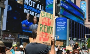 Protesters rally demanding economic relief during the coronavirus pandemic, at Time Square on 5 August 2020 in New York City.