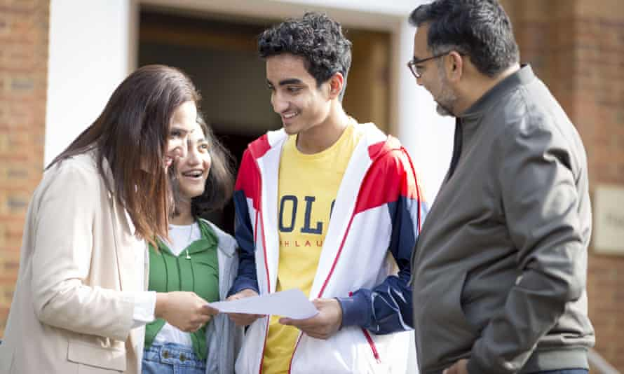 Pupil Meher-Ali Khokhar is joined by his family as he receives his GCSE results at Manchester grammar school on Thursday