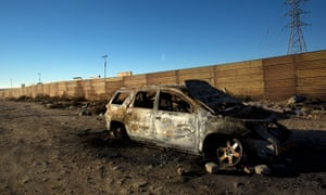 Pprototypes of the wall are seen on the US side of the border. In the Mexican side of Otay, the carcass of a burned vehicle lays where drug-violence has led more than a thousand dead people just in 2017.