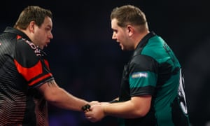 Adrian Lewis, left, congratulates Kevin Münch after the German's shock victory at Alexandra Palace.