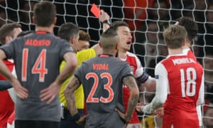 Laurent Koscielny reacts after referee Tasos Sidiropoulos shows him the red card.