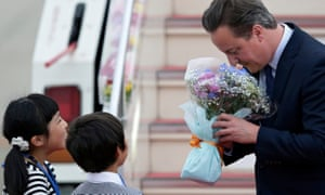 David Cameron accepts flowers as he arrives in Tokoname, Japan, for the G7 meeting.