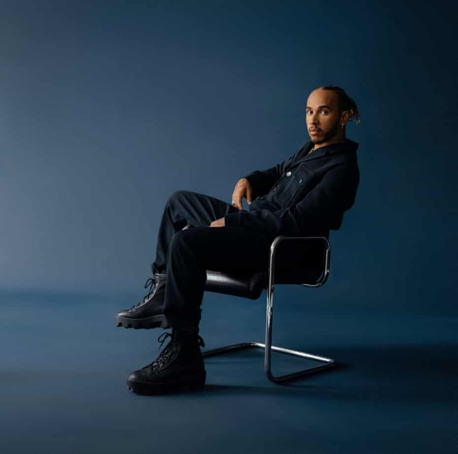 Lewis Hamilton wearing jumpsuit: Hugo Boss. Shoes: Converse. Jewellery: Chrome Hearts. Styling: Law Roach. Grooming: Laila Hayani.