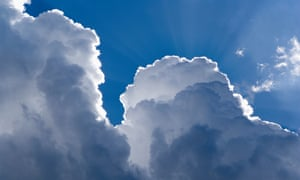 sunlit clouds in a blue sky