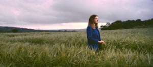 Schoolgirl Catriona Walsh stands in a barley field along the Irish border in Londonderry, Northern Ireland