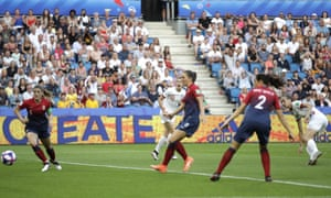 Englishman Jill Scott watches as her shot on goal goes past Norway's defenders and scores her team's first goal.